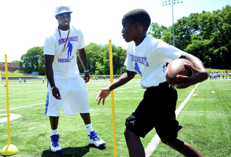 Former Husky and current Buffalo Bills wide receiver Marcus Easley coaches during his 2nd Annual E.A.S.Y (Excellence, Achievement, Striving, Youthful) Summer Camp, a one-day football camp for children 6-15 years old, at Bunnell High School in Stratford Saturday, June 30, 2012. Photo: Autumn Driscoll / Connecticut Post
