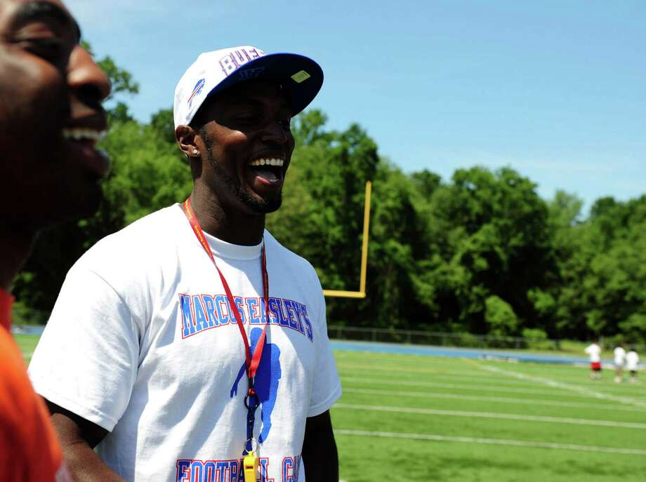 Former Husky and current Buffalo Bills wide receiver Marcus Easley holds his 2nd Annual E.A.S.Y (Excellence, Achievement, Striving, Youthful) Summer Camp, a one-day football camp for children 6-15 years old, at Bunnell High School in Stratford Saturday, June 30, 2012. Photo: Autumn Driscoll / Connecticut Post