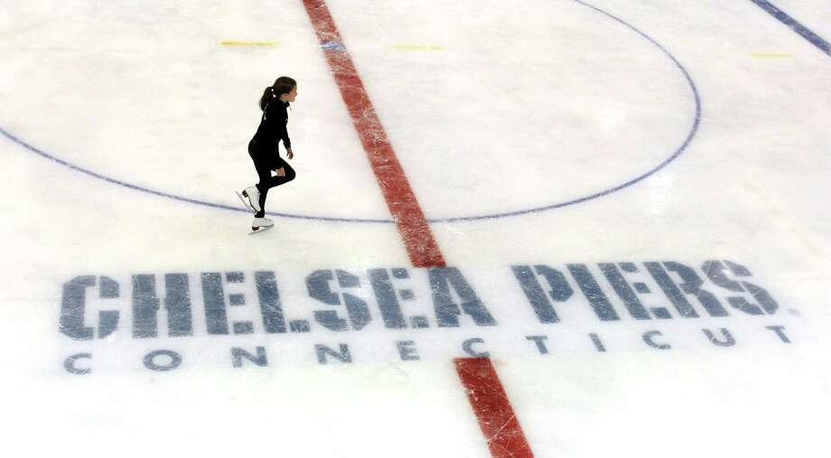 A skater practices on one of the two ice rinks at Chelsea Piers Connecticut. The Stamford, Conn. facility held their ceremonial ribbon cutting at their Blachley Road campus on Thursday June 28, 2012. Photo: Cathy Zuraw / Stamford Advocate