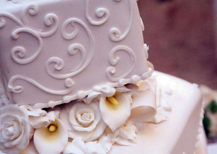 Jenn Press Arata has a local baker recreate the top of her wedding cake. Photo: Contributed Photo
