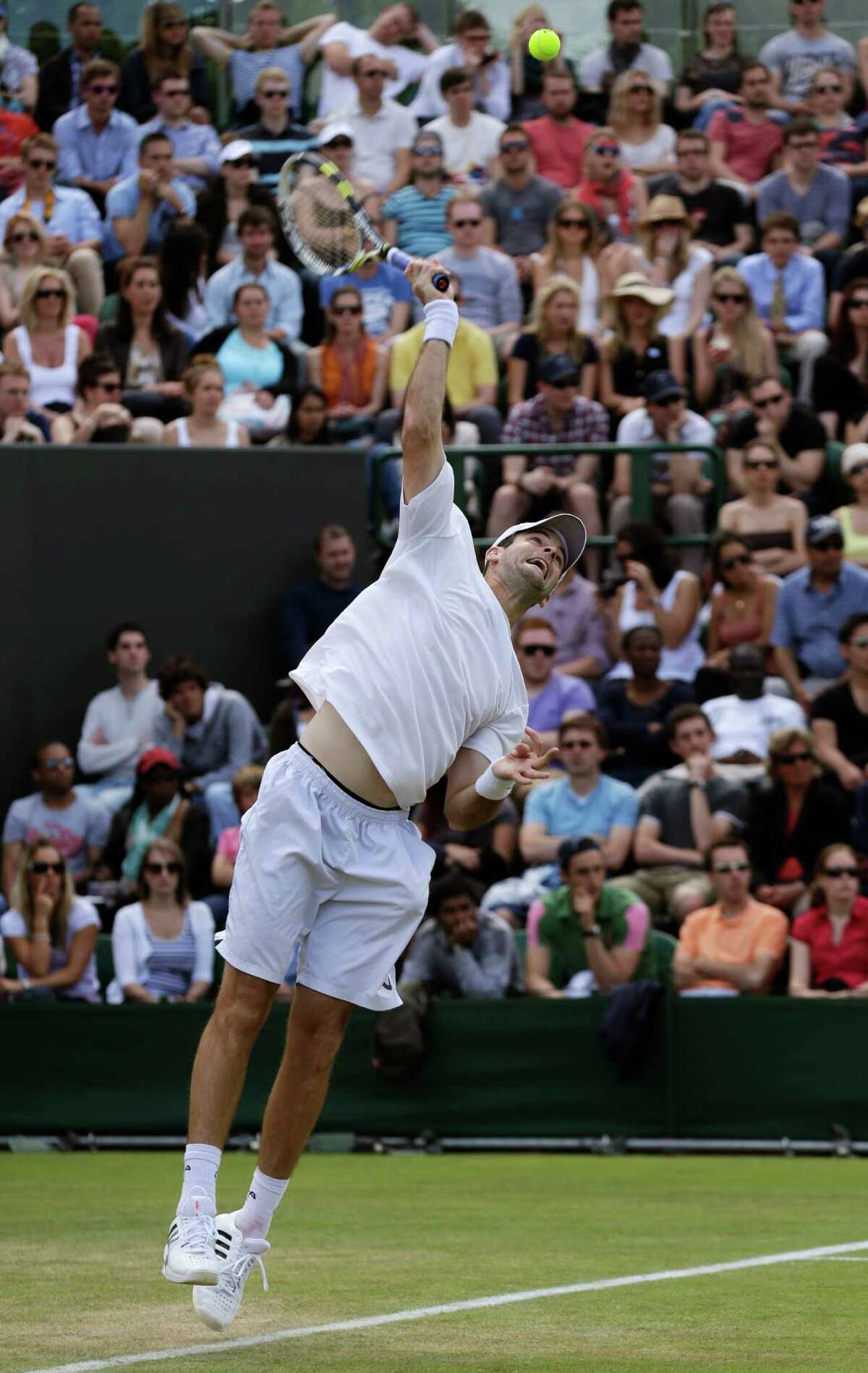 Brian Baker of the United States serves to Benoit Pare of France during a third round men's singles match at the All England Lawn Tennis Championships at Wimbledon, England, Saturday, June 30, 2012.