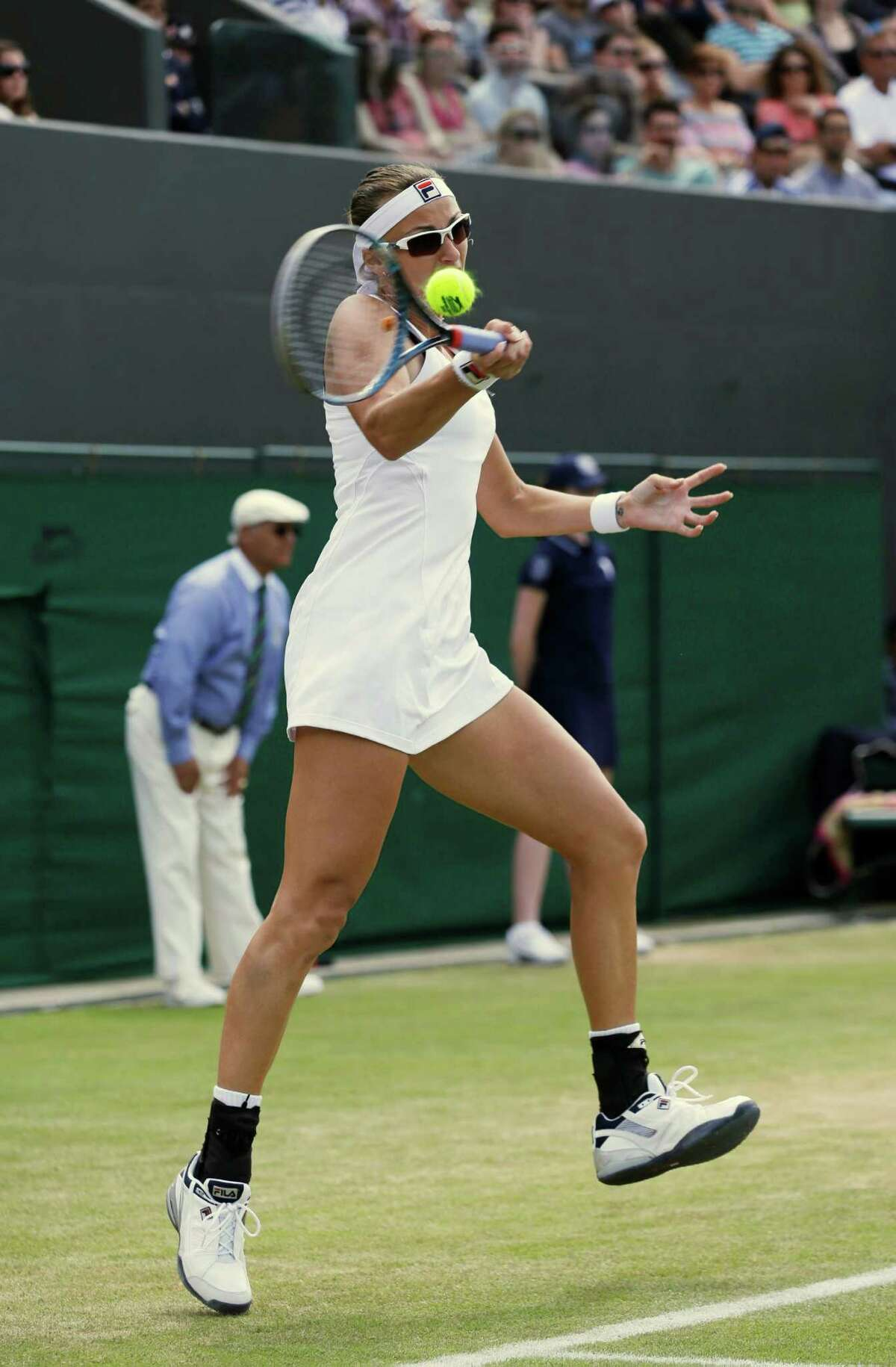Yaroslava Shvedova of Kazakhstan plays a return to Sara Errani of Italy during a third round women's singles match at the All England Lawn Tennis Championships at Wimbledon, England, Saturday, June 30, 2012.