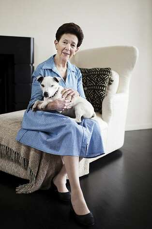 Philanthropist Roselyne Swig and her dog Spud sits for a portrait at her home in San Francisco, Calif. on Wednesday, May 16, 2012. Photo: Stephen Lam, Special To The Chronicle