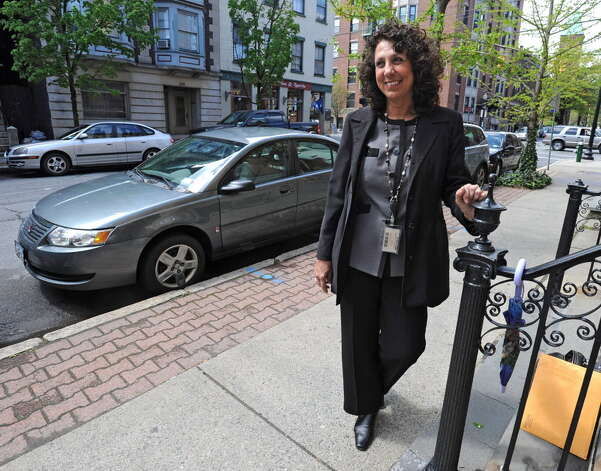 "Nadine Kozer, standing near where her car was ticketed and towed from State Street in Albany, fought City Hall and won. The Albany resident successfully contested her parking ticket and recouped the tow fee. ""People need to stand up for themselves,"" she said.  (Lori Van Buren / Times Union)"