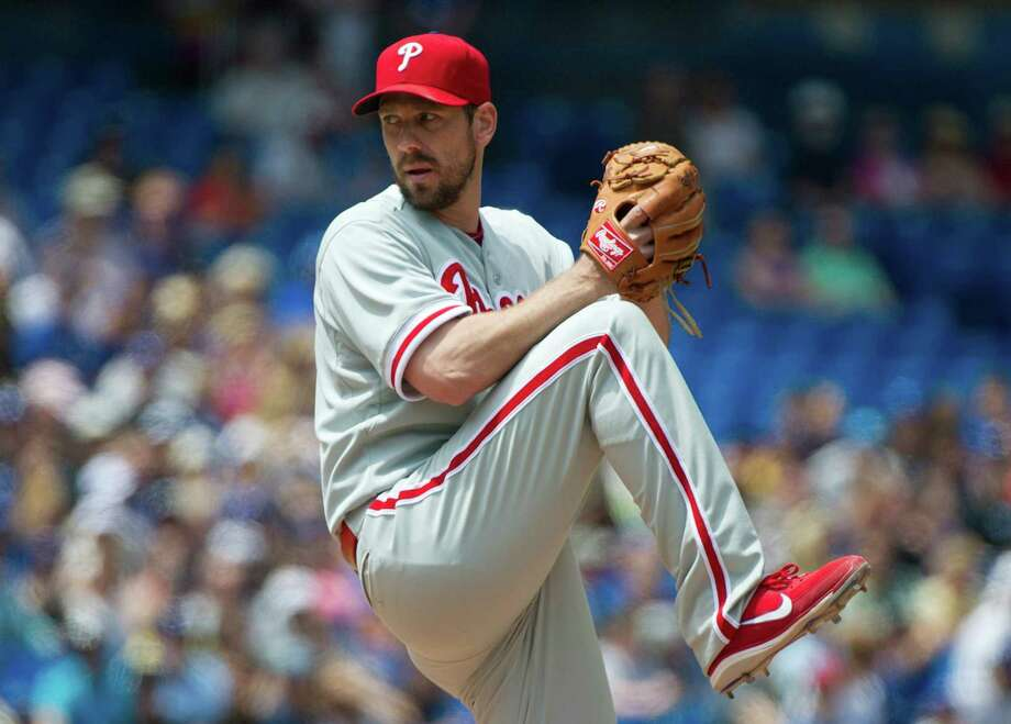 The Phillies' Cliff Lee, pitching at Toronto on June 16, is tied for 24th with 37 other players for the most starts (13) to open a season without a win since 1918. Photo: Nathan Denette, Associated Press