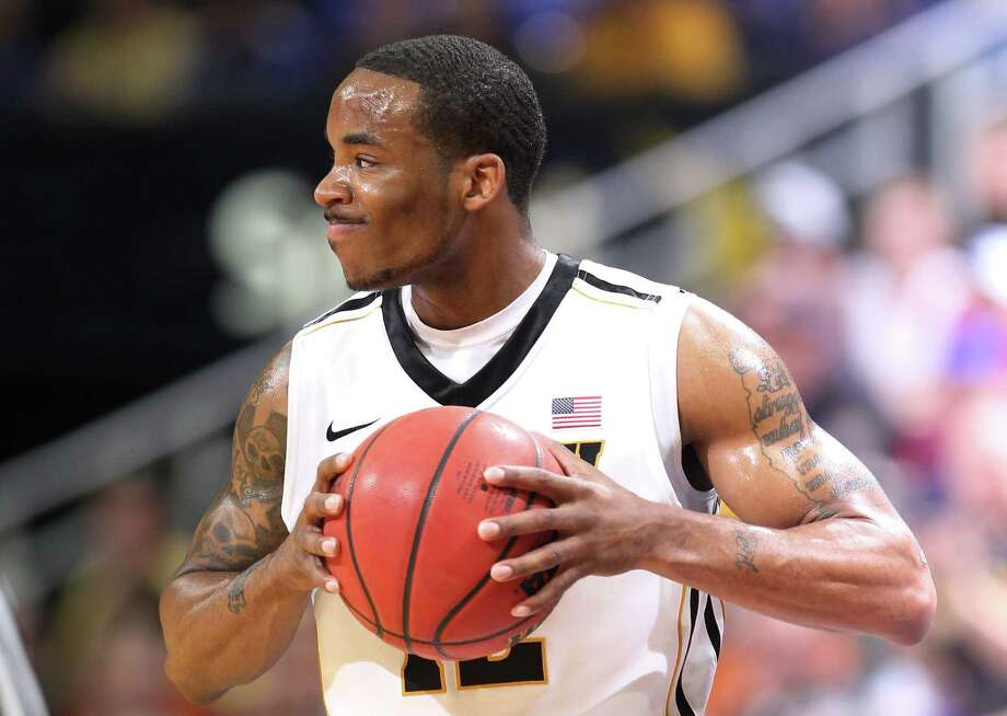 Marcus Denmon #12 of the Missouri Tigers reacts in the first half of their game against the Texas Longhorns during the semifinals of the 2012 Big 12 Men's Basketball Tournament at Sprint Center on March 9, 2012 in Kansas City, Missouri. Photo: Jamie Squire, Getty Images / 2012 Getty Images