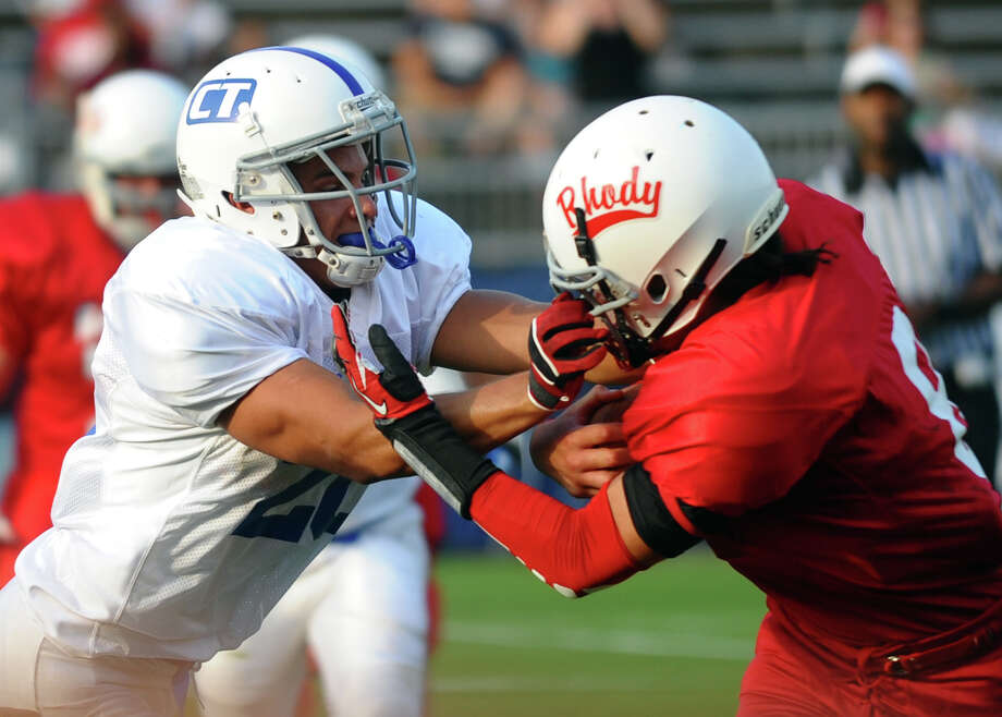 Connecticut's #20 Tommy Undercuffler, of Berlin, tackles Rhode Island's #8 Tucker Jamal, during the 2012 Govenors' Cup 14th Annual Senior High School All-star Football game at Rentschler Field in East Hartford, Conn. on Saturday June 30, 2012. Photo: Christian Abraham / Connecticut Post