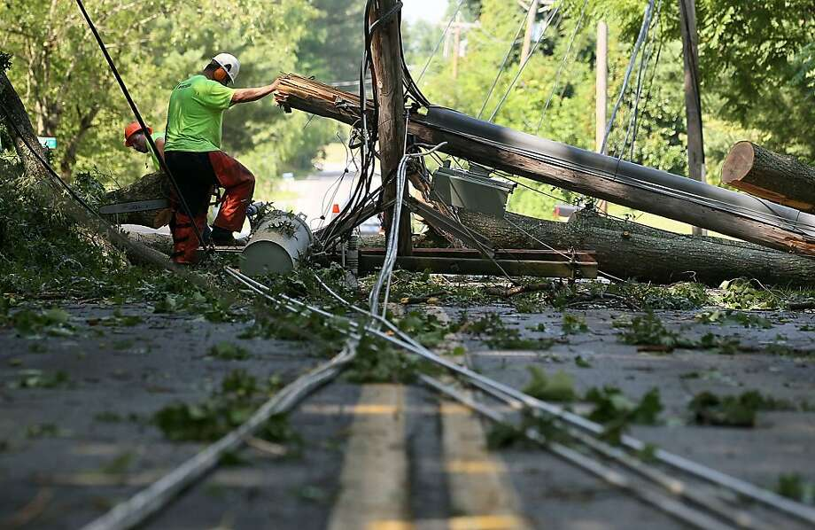 HUNTINGTOWN, MD - JUNE 30: Workers cut up a fallen tree, so that power lines can be repaired, on June 30, 2012 in Huntington, Maryland. Over a million homes across the Washington area lost power after a severe thunderstorm hit the area.   (Photo by Mark Wilson/Getty Images) *** BESTPIX *** Photo: Mark Wilson, Getty Images