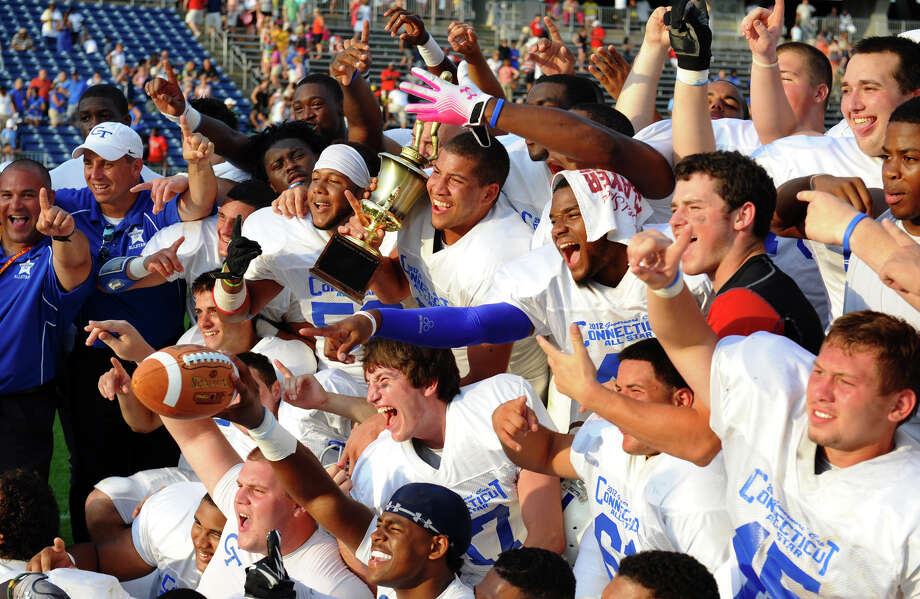 Connecticut shows off the trophy after defeating Rhode Island in the 2012 Govenors' Cup 14th Annual Senior High School All-star Football game at Rentschler Field in East Hartford, Conn. on Saturday June 30, 2012. Photo: Christian Abraham / Connecticut Post