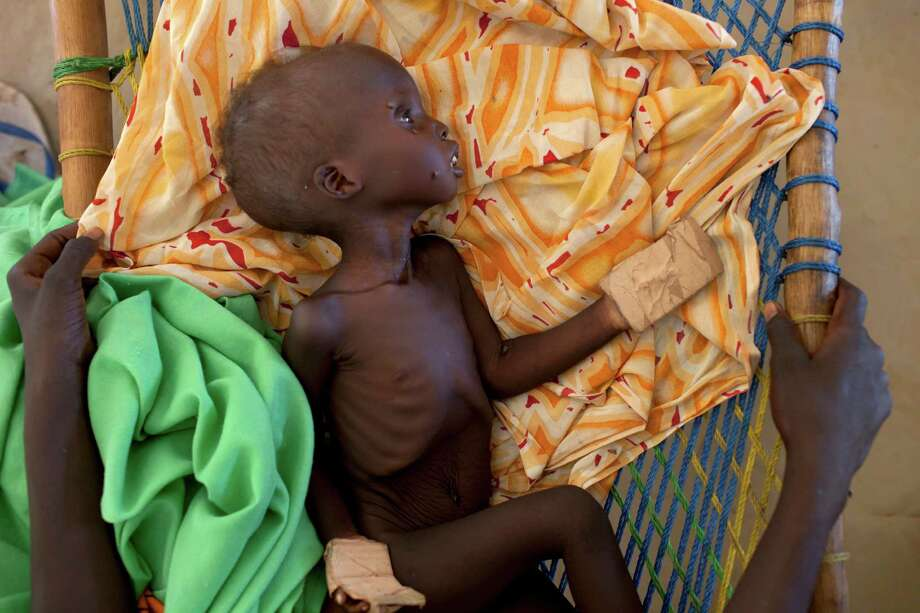 From sudan a new wave of lost boys san antonio express news a famished sudanese child at a refugee camp in yida south sudan where thousands publicscrutiny Gallery