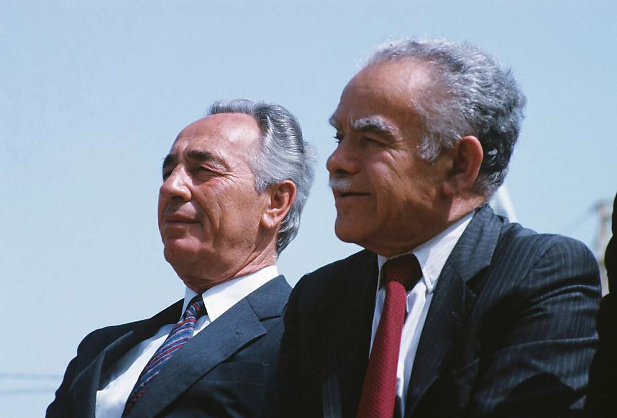 FILE - In this May 1, 1986 file photo, Israeli Prime Minister Shimon Peres and Foreign Minister Yitzhak Shamir are seen in Jerusalem. Former Israeli Prime Minister Yitzhak Shamir, who clung throughout his life to the belief that Israel should hang on to territory and never trust an Arab regime, has died. He was 96 years old. Israeli media said he died at a nursing home in Herzliya Saturday, June 30, 2012, while Israeli Prime Minister Benjamin Netanyahu issued a statement mourning Shamir's death.(AP Photo, File)