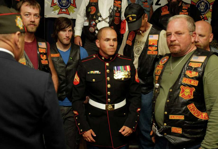 "Marine Cpl. Christopher Farias, who earned the Navy Cross and Purple Heart, was given a hero's welcome Saturday in La Porte. He was cited for ""fearless actions and leadership"" during combat in Afghanistan. Photo: Melissa Phillip / © 2012 Houston Chronicle"
