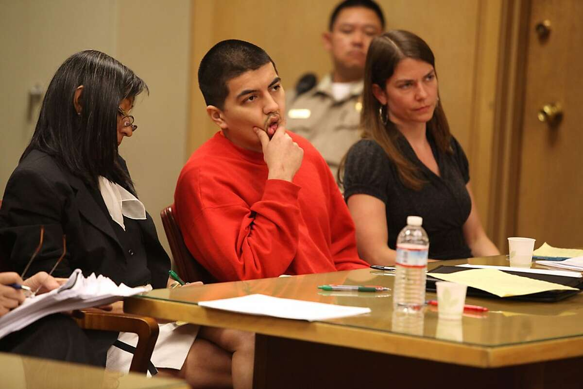 Edwin Ramos, the man who shot and killed a father and his two sons in a mistaken gang shooting in 2008 listening to his sentence today in San Francisco, California, on Monday, June 11, 2012.