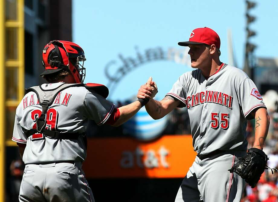 Cincinnati Reds starting pitcher Mat Latos right is greeted by his catcher Ryan Hanigan after defeated the San Francisco Giants' 2-1 Saturday, June 30, 2012, in San Francisco. Photo: Lance Iversen, The Chronicle