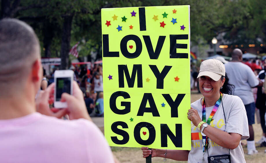 Norma Ortega poses for photos while holding a sign for her son and his boyfriend during the Pride Bigger Than Texas Festival & Parade held Saturday June 30, 2012 at Crockett Park. Photo: Edward A. Ornelas, San Antonio Express-News / © 2012 San Antonio Express-News