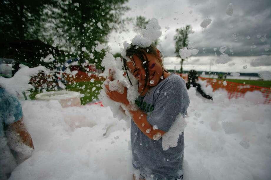 Avalyn Lara plays in a foam pit. Photo: SOFIA JARAMILLO / SEATTLEPI.COM