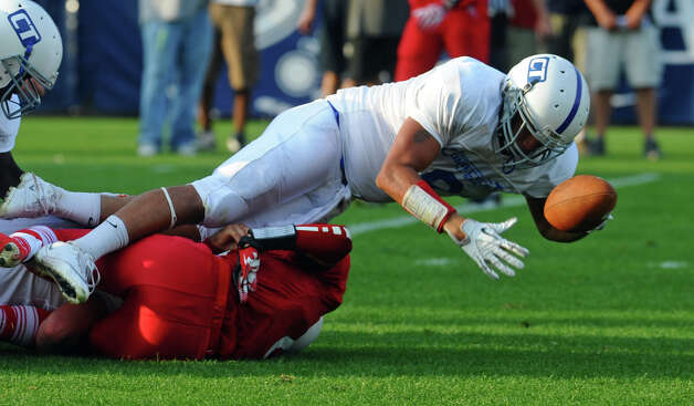 Jovan Santos-Knox, of Xavier, gets tackled by Rhode Island, during the 2012 Govenors' Cup 14th Annual Senior High School All-star Football game at Rentschler Field in East Hartford, Conn. on Saturday June 30, 2012. Photo: Christian Abraham / Connecticut Post