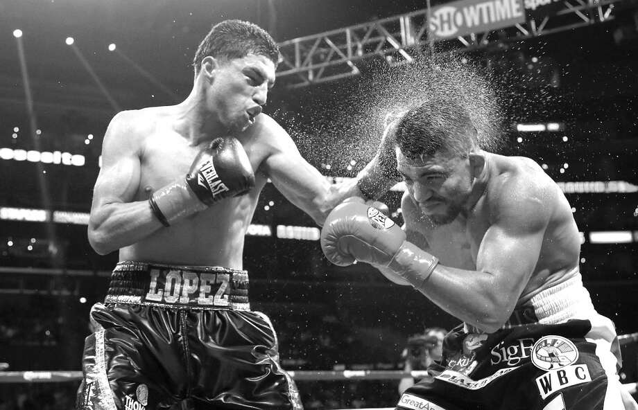 Josesito Lopez (left) lands a shot to the head of Victor Ortiz in the fifth round of their WBC welterweight bout in Los Angeles on June 23. Lopez upset the heavily favored Ortiz. Photo: Jae C. Hong, Associated Press / AP