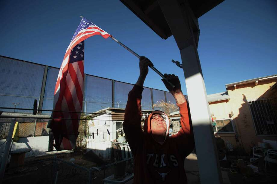 """I believe 100 percent we need it,"" Navy veteran Jesus Maldonado, 69, declares of the border barrier that towers over his backyard in El Paso's Chihuahuita neighborhood. ""Ever since they put that fence in, you can sleep."" Photo: Mayra Beltran / © 2012 Houston Chronicle"