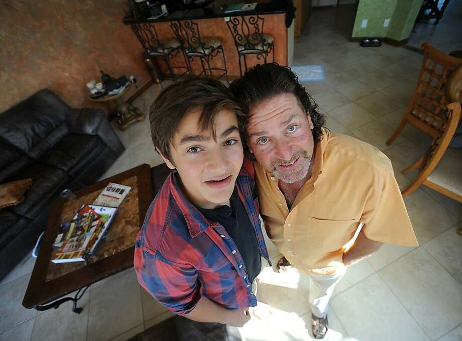 Ron Dash, right, with his son Sam Dash pose for portrait, June 13, 2012, in Palm Beach Gardens, Florida. Ron Dash, born in the middle of the baby boom, started smoking weed at age 13. He went on to run his own business, married and raised a family. But he increasingly had problems with prescription and illegal drugs. Finally, after his wife threatened to leave and take their son, he got help and has been sober since 2006. (Jim Rassol/Sun Sentinel/MCT) Photo: Jim Rassol, McClatchy-Tribune News Service