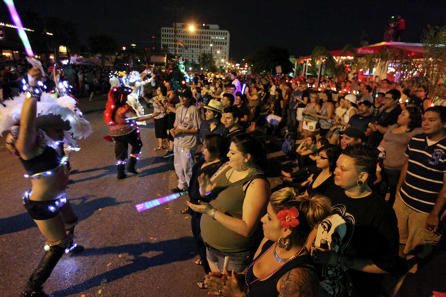 Crowds watch the Pride Bigger Than Texas Parade pass Saturday, June 30, 2012. Photo: Edward A. Ornelas, San Antonio Express-News / © 2012 San Antonio Express-News