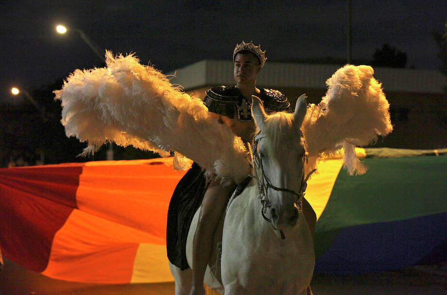 Steven Olague as, Zeus, and the horse Blair, as Pegasus, take part in the Pride Bigger Than Texas Festival & Parade held Saturday, June 30, 2012. Photo: Edward A. Ornelas, San Antonio Express-News / © 2012 San Antonio Express-News