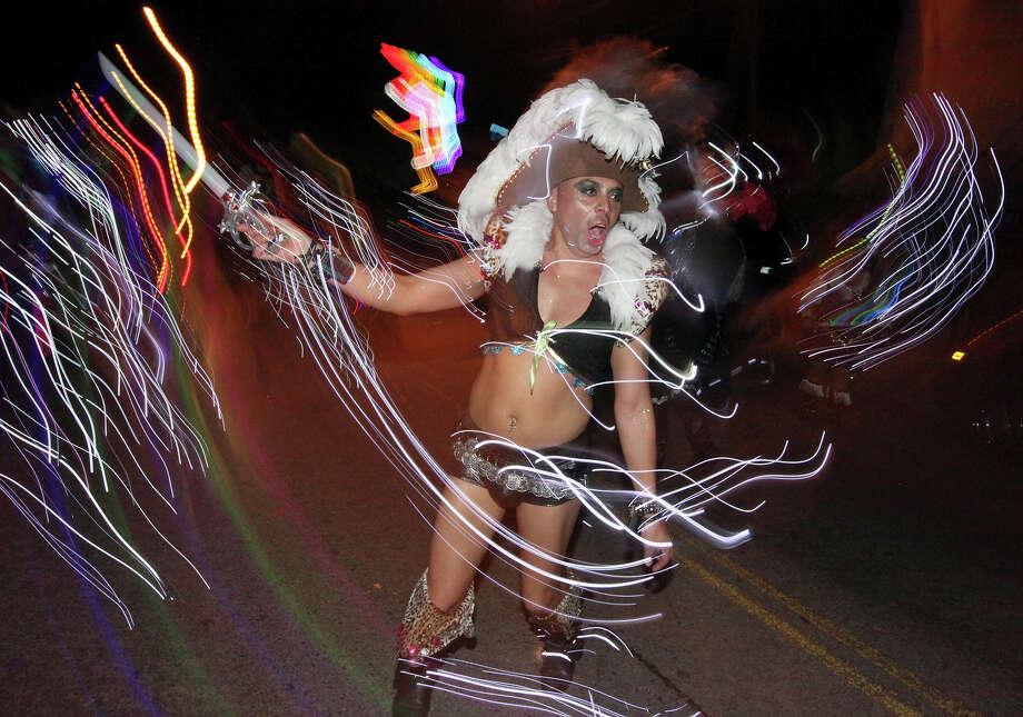 San Antonio Street Dance & Drum Company member John Nunez takes part in the Pride Bigger Than Texas Parade held Saturday, June 30, 2012. Photo: Edward A. Ornelas, San Antonio Express-News / © 2012 San Antonio Express-News