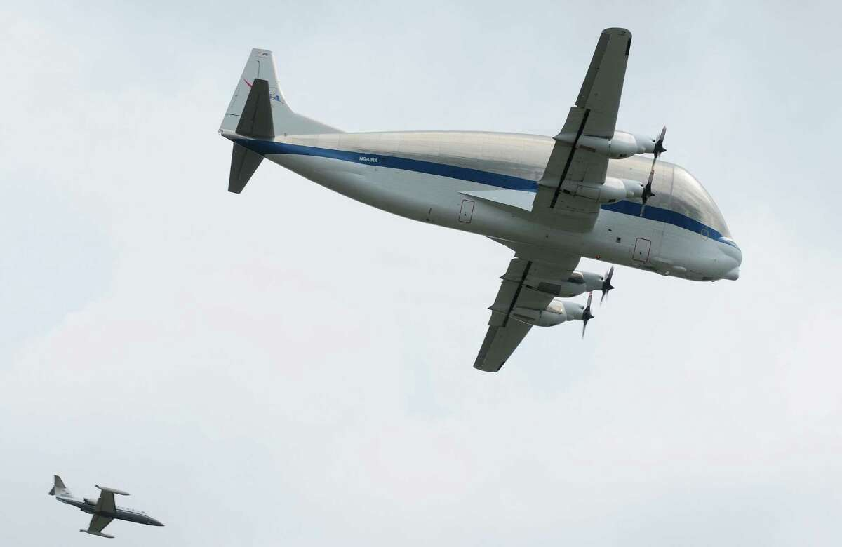 NASA's Super Guppy aircraft, carrying the Space Shuttle Trainer, flies by the Museum of Flight in Seattle with a chaser plane on Saturday, June 30, 2012. The rest of the Space Shuttle Trainer will be delivered to the museum in several stages over the next few months.