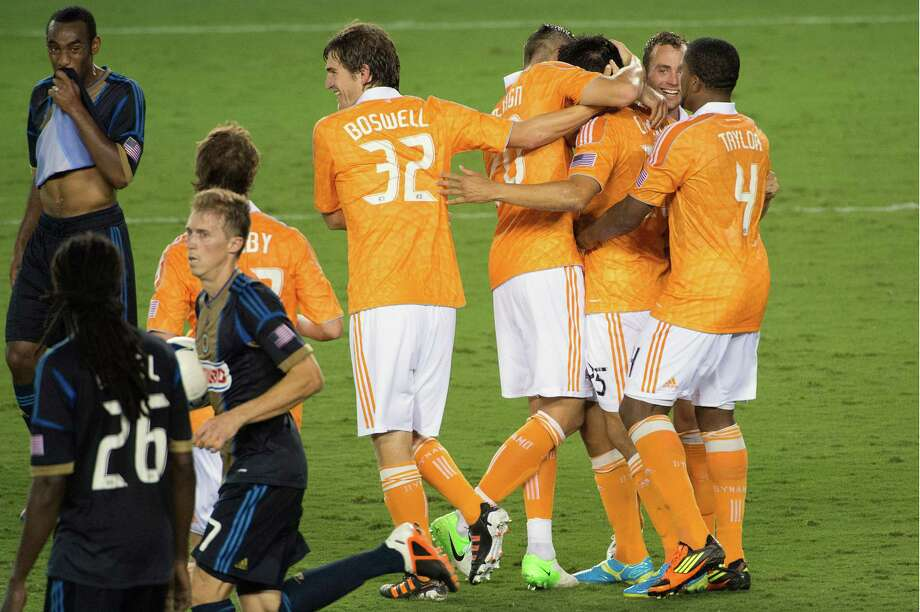 Houston Dynamo players celebrate after Brian Ching (25) scored on a penalty kick during the second half against the Philadelphia Union. Photo: Smiley N. Pool, Houston Chronicle / © 2012  Houston Chronicle