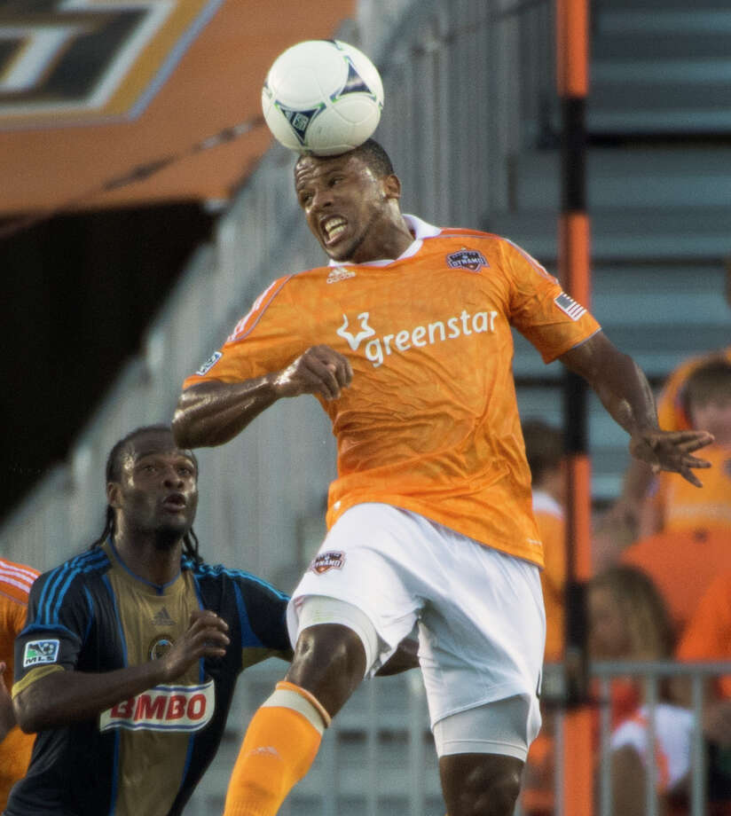 Jermaine Taylor wins a header over Keon Daniel. Photo: Smiley N. Pool, Houston Chronicle / © 2012  Houston Chronicle