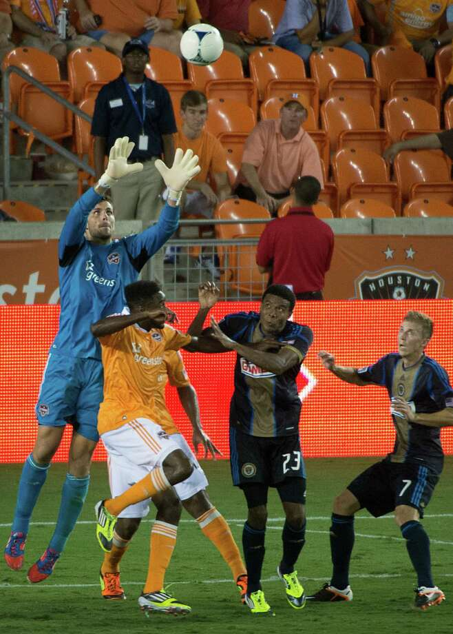 Dynamo goalkeeper Tally Hall makes a stop in the final moments of the second half. Photo: Smiley N. Pool, Houston Chronicle / © 2012  Houston Chronicle