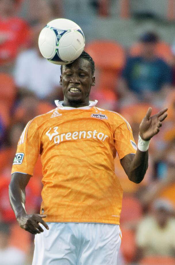 Macoumba Kandji heads a ball during the first half. Photo: Smiley N. Pool, Houston Chronicle / © 2012  Houston Chronicle