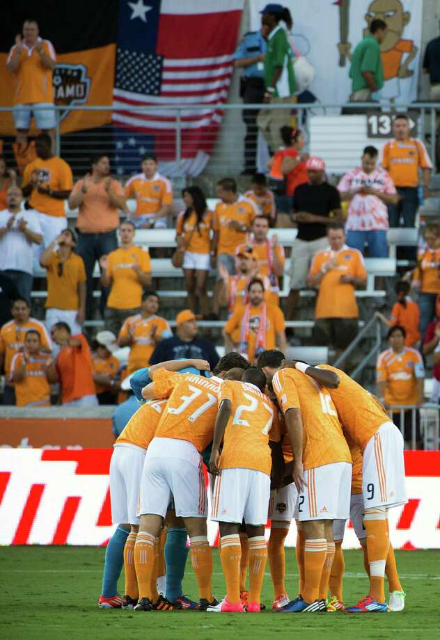 Houston Dynamo players huddle before facing the Philadelphia Union. Photo: Smiley N. Pool, Houston Chronicle / © 2012  Houston Chronicle