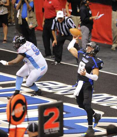 San Antonio Talons quarterback Aaron Garcia throws from the end zone during Arena Football League action against Kansas City in the Alamodome on Saturday, June, 30, 2012. Photo: Billy Calzada, San Antonio Express-News / © 2012 San Antonio Express-News