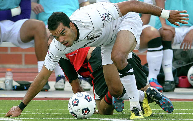 San Antonio's Pablo Campos recovers from a tackle and heads for the goal as the San Antonio Scorpions host the Atlanta Silverbacks at Heroes Stadium on June 30, 2012. Photo: Tom Reel, San Antonio Express-News / ©2012 San Antono Express-News