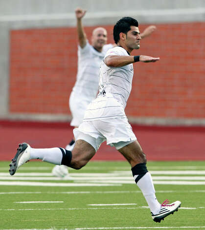 Esteban Bayona glides over the field after scoring as the San Antonio Scorpions host the Atlanta Silverbacks at Heroes Stadium on June 30, 2012. Photo: Tom Reel, San Antonio Express-News / ©2012 San Antono Express-News