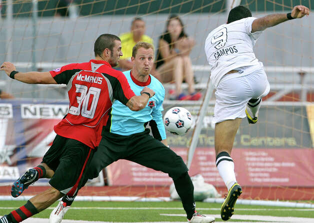 San Antonio's Pablo Campos takes a close range shot at the goal but his effort is nullified by a handball ruling as the San Antonio Scorpions host the Atlanta Silverbacks at Heroes Stadium on June 30, 2012. Photo: Tom Reel, San Antonio Express-News / ©2012 San Antono Express-News