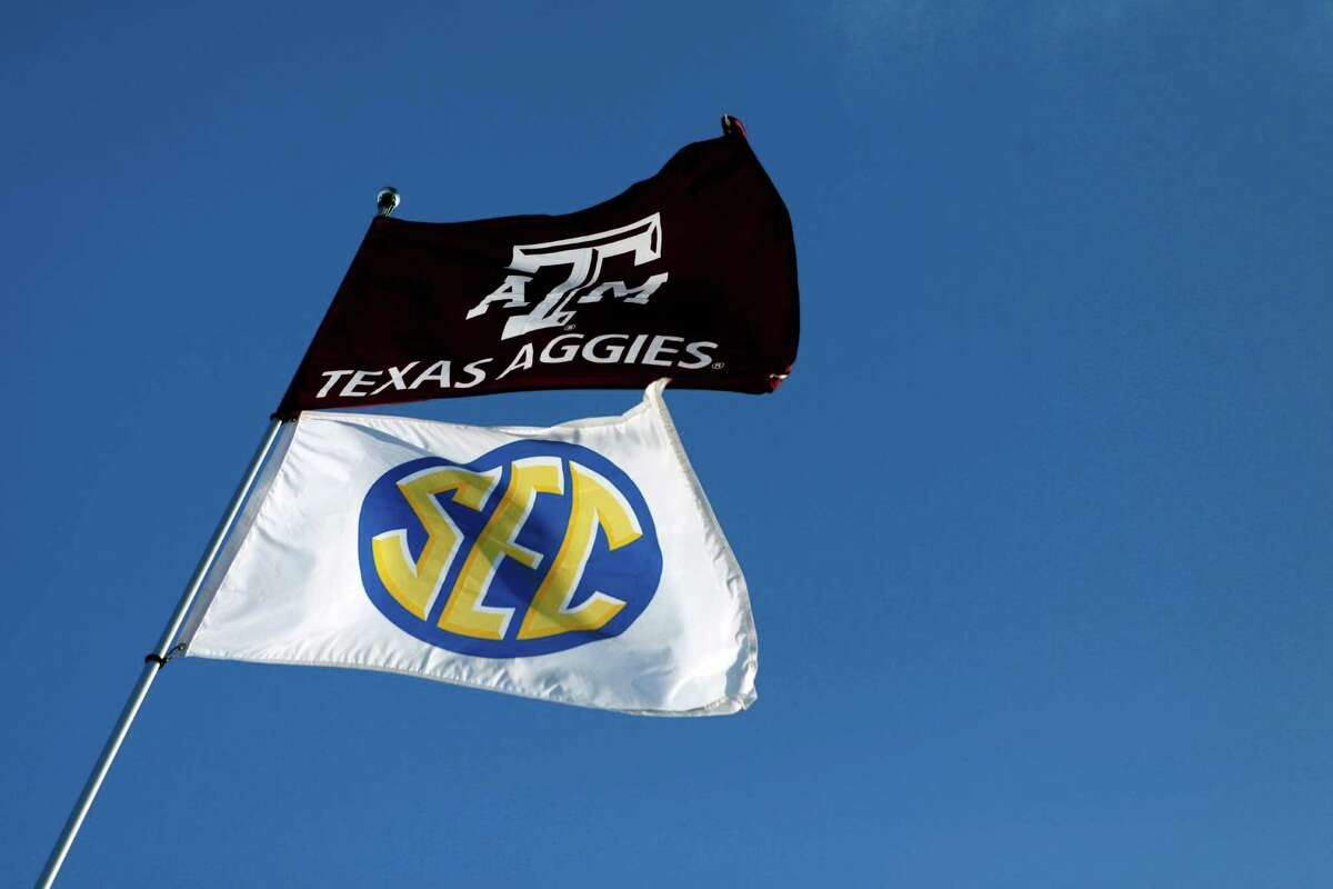 A Texas Aggies and an SEC Flag fly together over tailgaters before the start of the Texas A&M Aggies vs University of Texas Longhorns rivalry NCAA football game at Kyle Field on Thanksgiving Day, Thursday, November 24, 2011 in College Station, Texas. (Patrick T. Fallon/The Dallas Morning News)