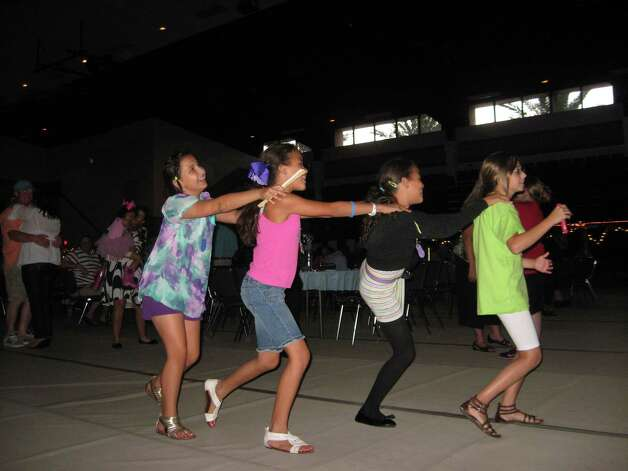 Twin sisters Courtney and Lesley Fitch and friends Kayce Rezsutek and Kourtney Hart, all age 10, enjoy themselves at Southern Summer Nights, an event benefiting the Port Arthur International Seafarers Center. Photo: Sarah Moore