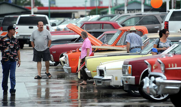 Enthusiasts check out the classic cars on display during car show at Classic of Southeast Texas in Beaumont, Saturday, June 30, 2012. Tammy McKinley/The Enterprise Photo: TAMMY MCKINLEY