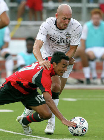 Atlanta's Danilo Turcios gets jammed away from the ball by Hans Denissen as the San Antonio Scorpions host the Atlanta Silverbacks at Heroes Stadium on June 30, 2012. Photo: Tom Reel, San Antonio Express-News / ©2012 San Antono Express-News
