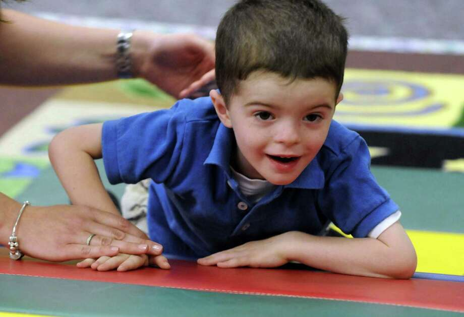 Three-year-old Charlie Dague, who suffers from an extremely rare form of muscular dystrophy, during a recent physical therapy at Kids Care Rehab Services in Niskayuna N.Y. Friday June 22, 2012. (Michael P. Farrell/Times Union) Photo: Michael P. Farrell