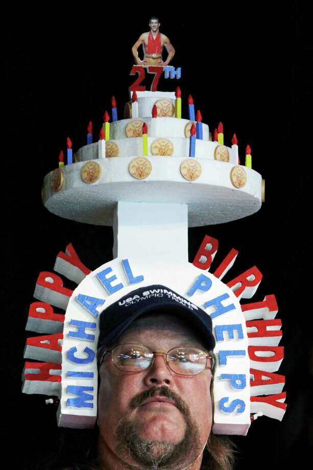 Mark Brandt, of Anderson, Ind., wears a hat shaped as a birthday cake for Michael Phelps at the U.S. Olympic swimming trials, Saturday, June 30, 2012, in Omaha, Neb. Photo: Nati Harnik, Associated Press / AP