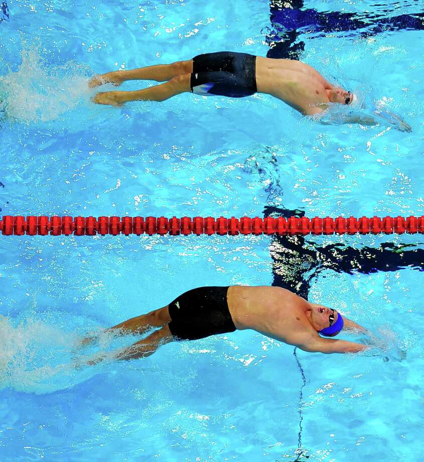 Tyler Clary, top, and Ryan Lochte compete in the men's 200-meter backstroke final at the U.S. Olympic swimming trials, Saturday, June 30, 2012, in Omaha, Neb. Photo: Mark J. Terrill, Associated Press / AP