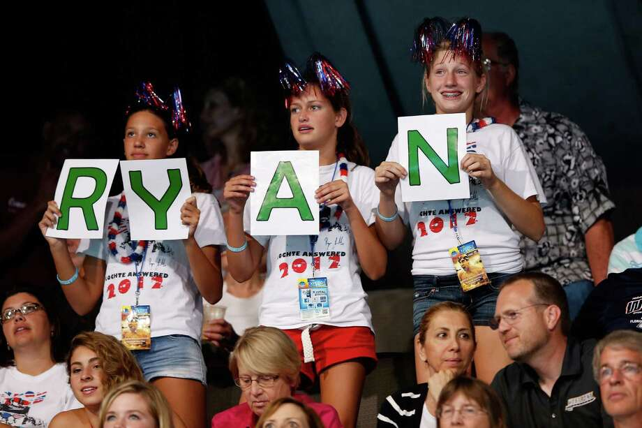 Fans show support for Ryan Lochte during Day Six of the 2012 U.S. Olympic Swimming Team Trials at CenturyLink Center on June 30, 2012 in Omaha, Nebraska. Photo: Jamie Squire, Getty Images / 2012 Getty Images