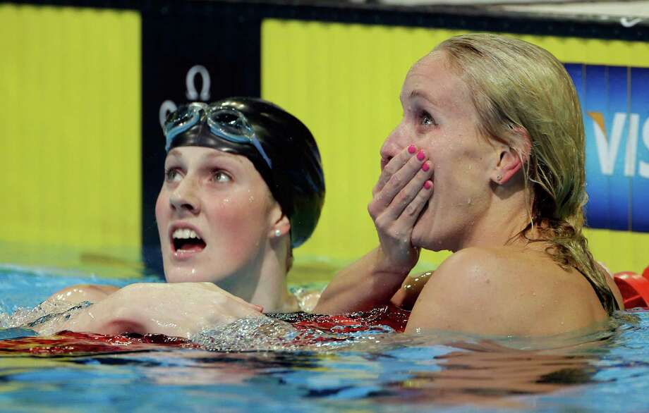 Jessica Hardy, right, reacts as Missy Franklin congratulates her after winning the women's 100-meter freestyle final at the U.S. Olympic swimming trials on Saturday, June 30, 2012, in Omaha, Neb. Photo: Mark Humphrey, Associated Press / AP