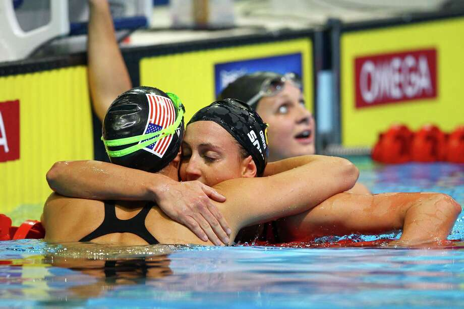 Rebecca Soni hugs Amanda Beardafter Soni won the Championship final of the Women's 200 m Breaststroke during Day Six of the 2012 U.S. Olympic Swimming Team Trials at CenturyLink Center on June 30, 2012 in Omaha, Neb. Photo: Al Bello, Getty Images / 2012 Getty Images
