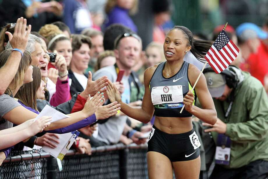 Allyson Felix celebrates with fans on her victory lap after winning the Women's 200 Meter Dash Final on day nine of the U.S. Olympic Track & Field Team Trials at the Hayward Field on June 30, 2012 in Eugene, Oregon. Photo: Christian Petersen, Getty Images / 2012 Getty Images