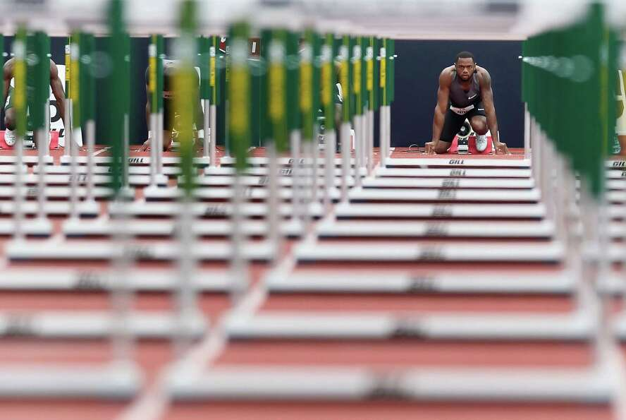 David Payne gets set on the starting block before the Men's 110 Meter Hurdles Semi-Final on day nine