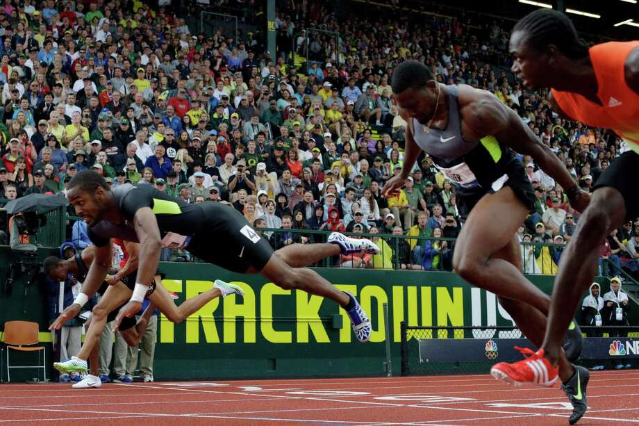 Jeffery Porter, left, crosses the finish line during the men's 110 meter hurdles final at the U.S. Olympic Track and Field Trials Saturday, June 30, 2012, in Eugene, Ore. Photo: Matt Slocum, Associated Press / AP